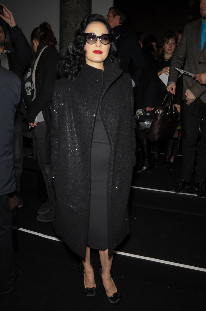 Dita Von Teese made an appearance at Elie Saab's show in a head-to-toe black ensemble, including dramatic cat-eye sunglasses and a sparkly coat.