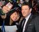 Cory Monteith posed with a fan at the Glee movie event in LA back in August 2011.
