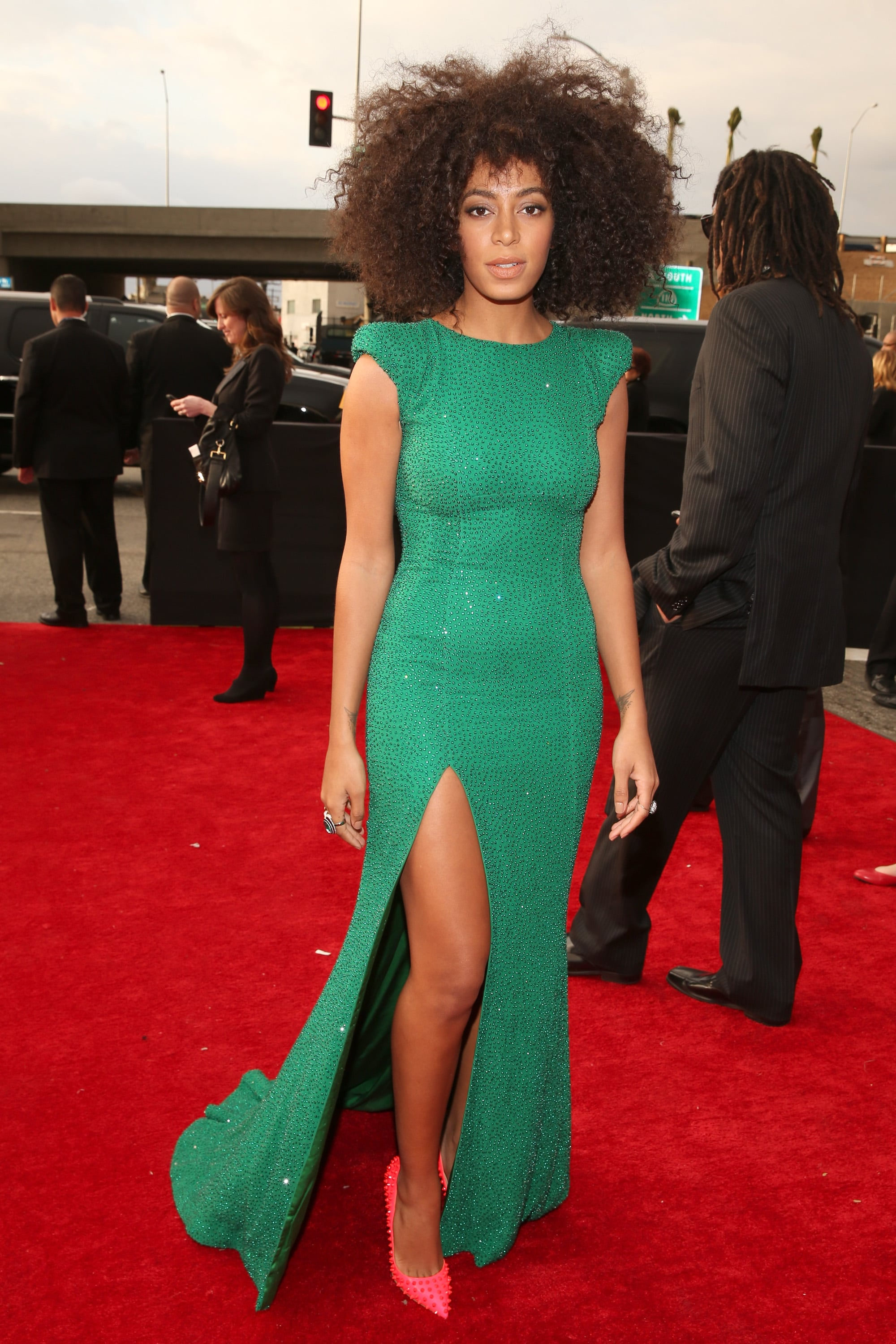 Solange Knowles showed off her leg in a green gown with a high slit for the Grammys.