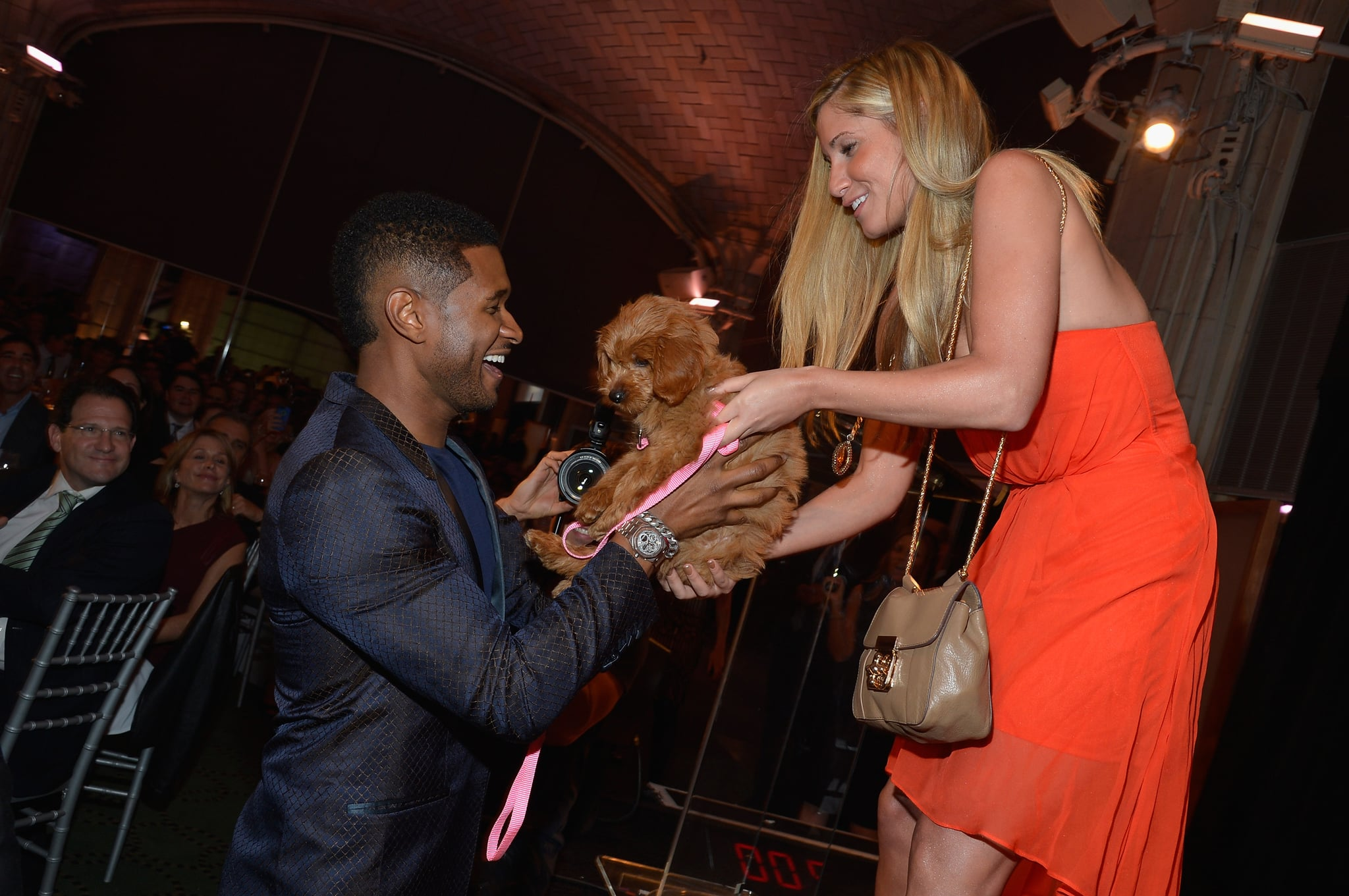 Usher was handed his new puppy.