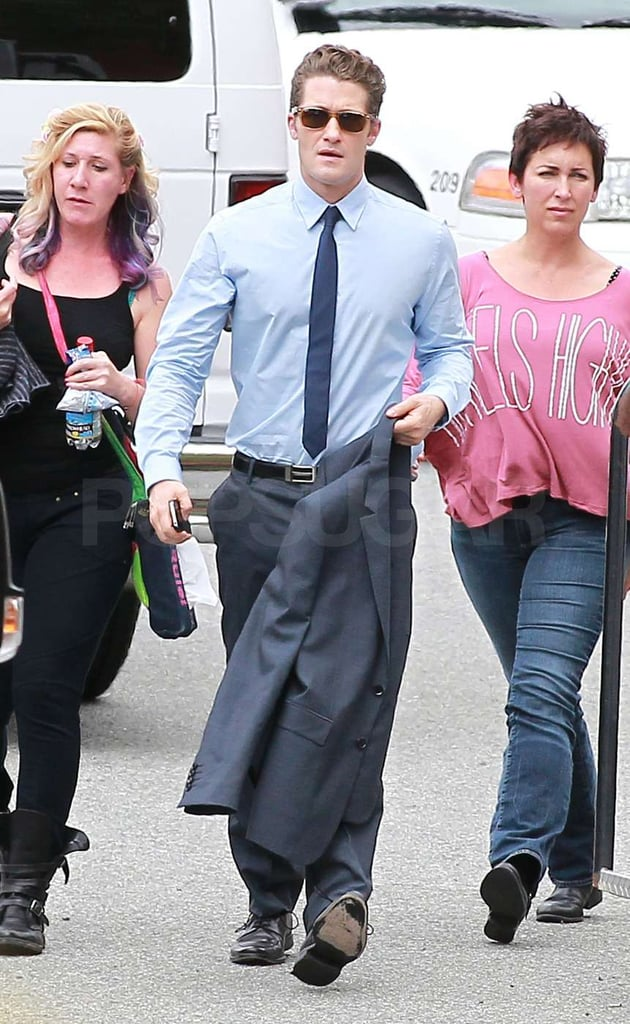 Matthew Morrison walked with his jacket in his hand on the set of Glee.