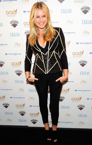 Pictures of Rebecca Romijn Wearing a Piped Jacket