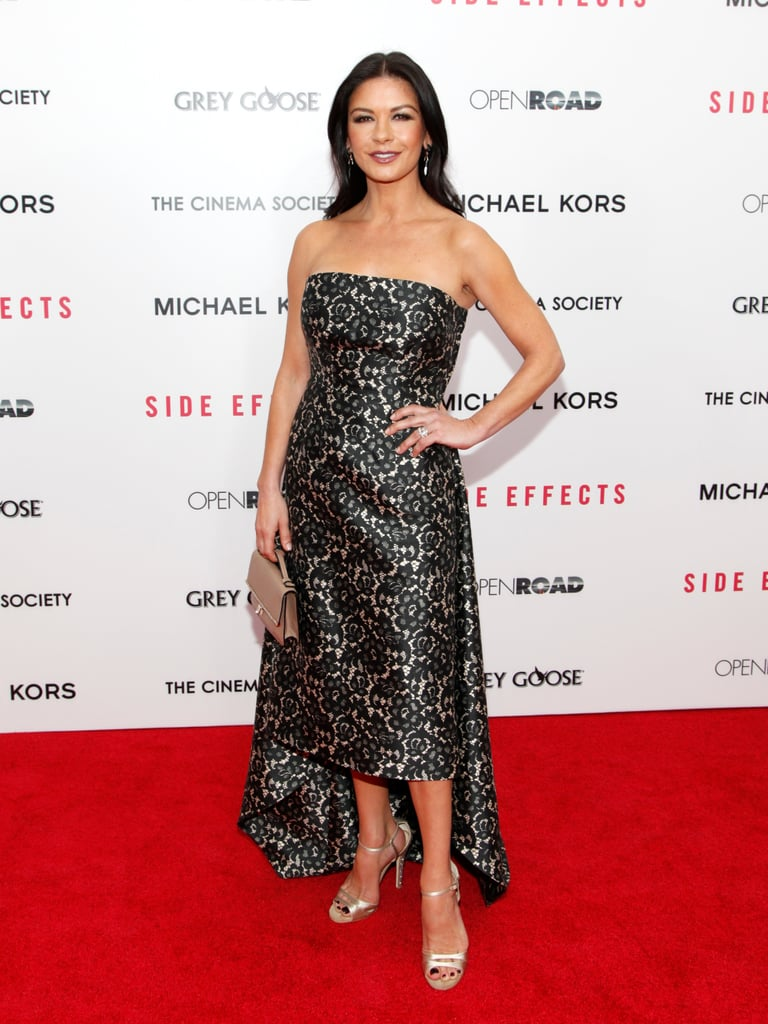 Catherine Zeta-Jones stepped out on the red carpet, looking better than ever, in a lace-print Michael Kors strapless.