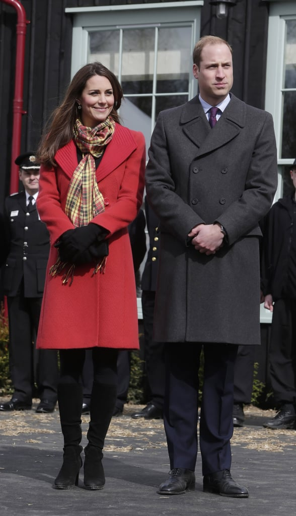 She wore a red Armani coat, complete with yellow plaid scarf, for a visit to the Dumfries House in Scotland.