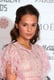 Alicia Wikander went pink on the red carpet.