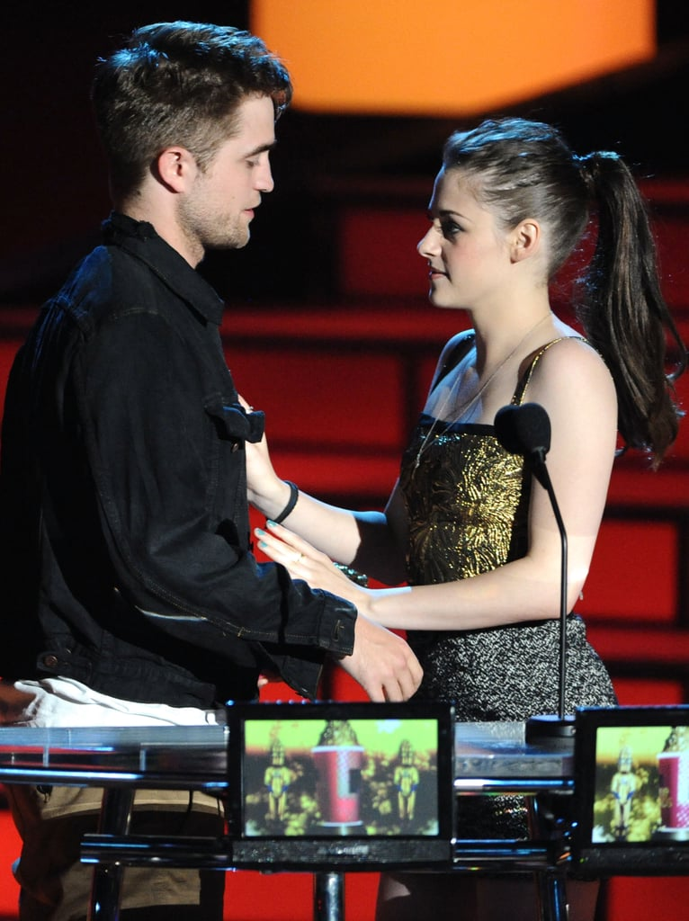 Robert Pattinson and Kristen Stewart got cozy while staging a kiss at the June 2010 MTV Movie Awards in LA.