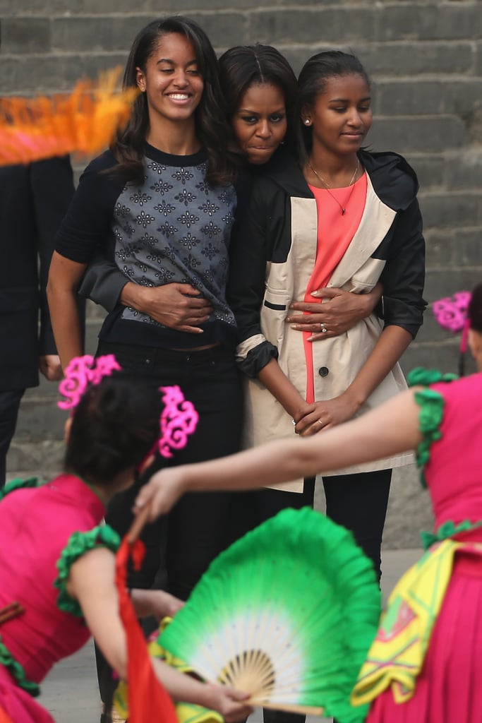In March 2014, the three took a trip to China. They might be growing, but Michelle can still give them one giant hug!