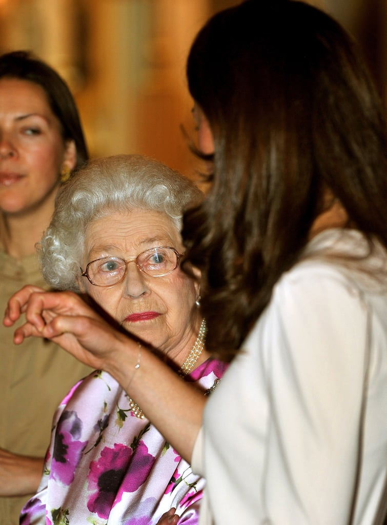 Kate Middleton and Queen Elizabeth chat.