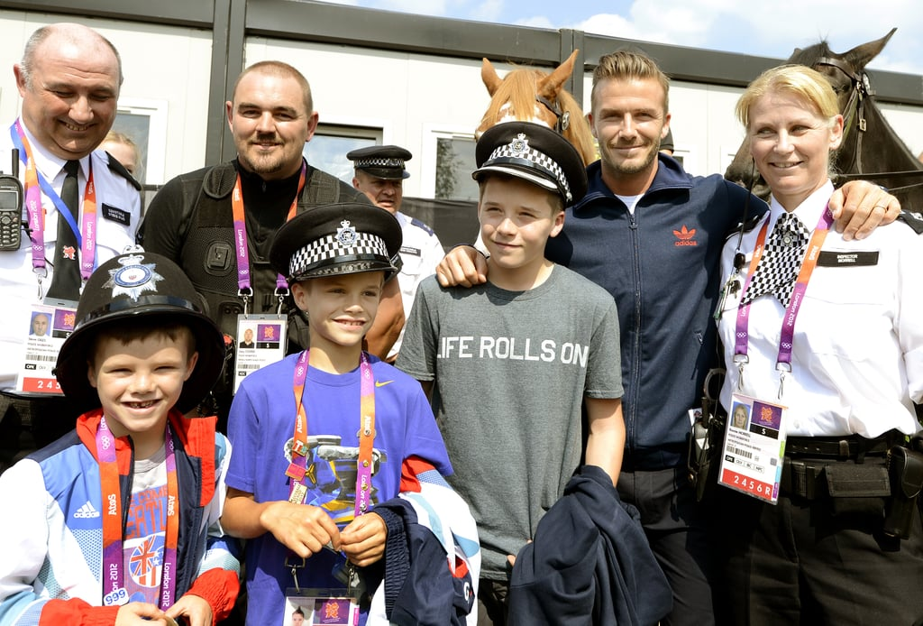 David Beckham and his sons, Romeo Beckham, Cruz Beckham, and Brooklyn Beckham, posed with the Security Personnel team.