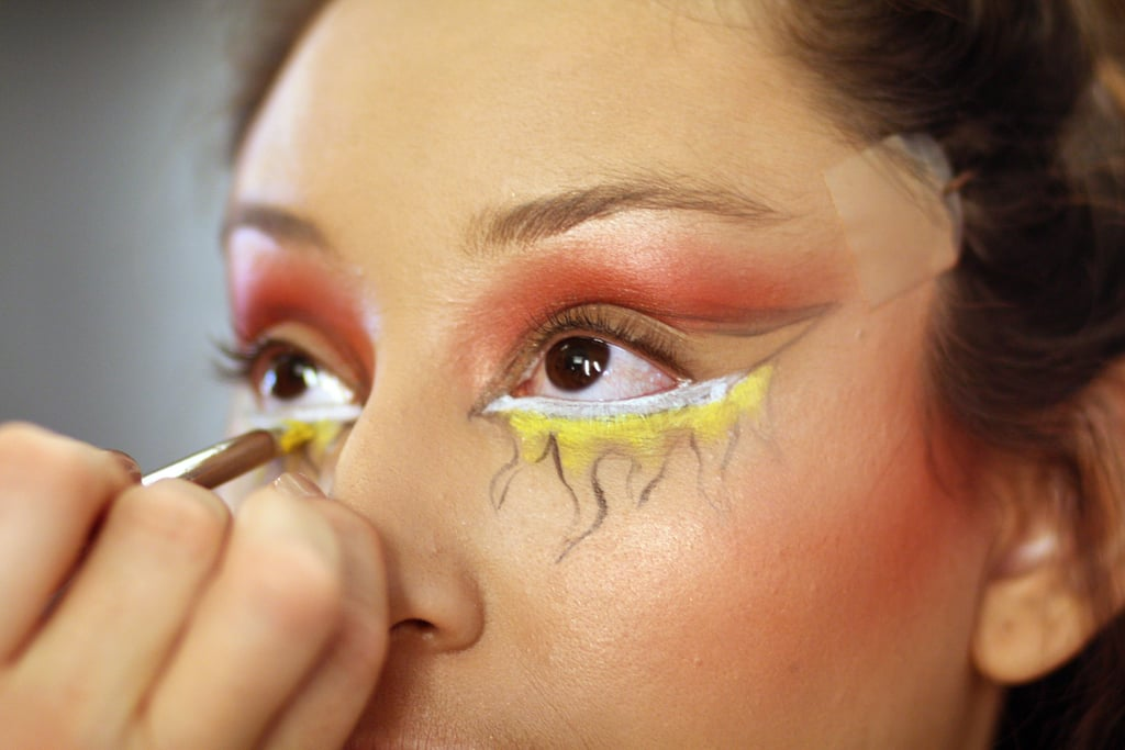 Here's where the right tools make all the difference. To create the look of fire, Zizzo reached for Chromaline. The pro-only product is waterproof and sweatproof — perfect for Halloween. For precise application, Zizzo used the angled 266 brush to apply white Chromaline, then chose the 219 pencil brush to start filling in the flames with Primary Yellow.