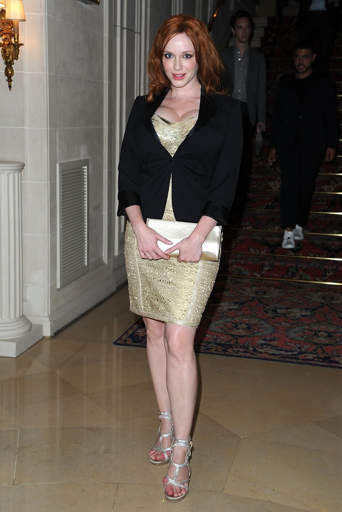 Christina Hendricks arrived at the Versace show for Paris Fashion Week wearing a gold dress.