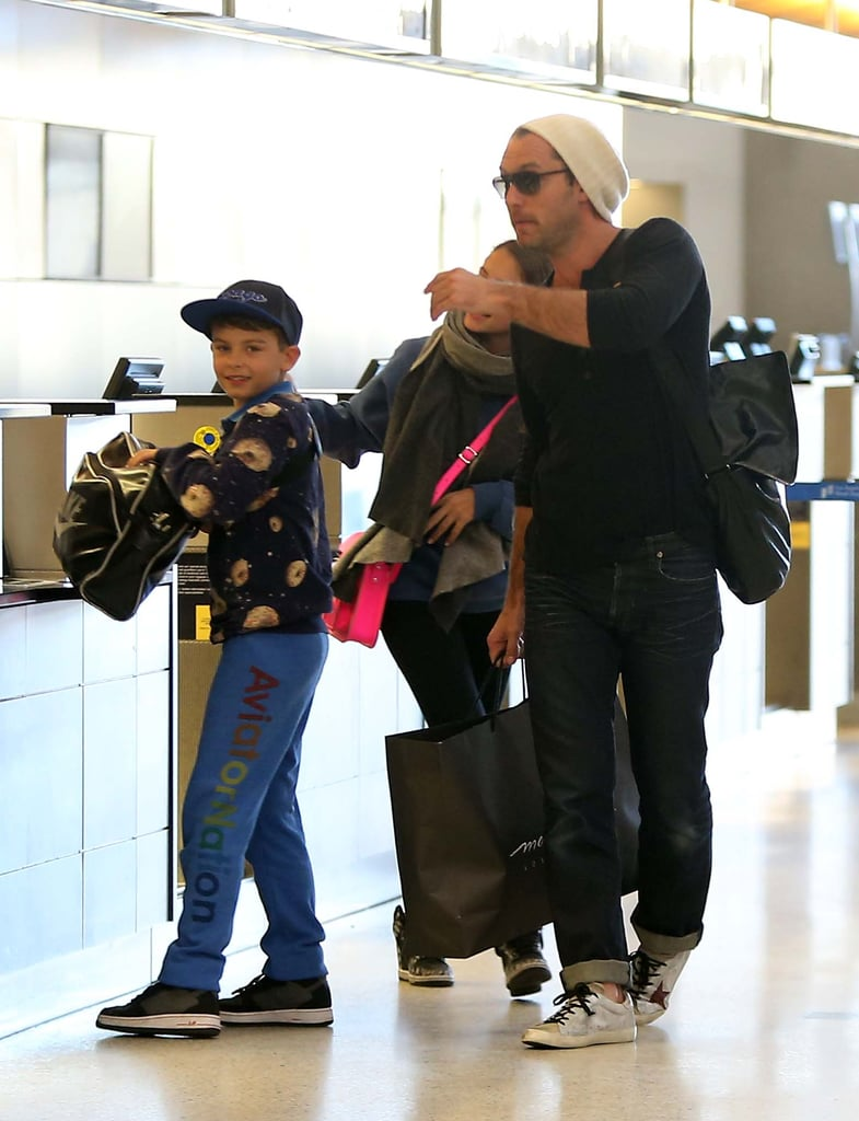 Jude Law and his children prepared for a trip.