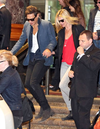 Kate Moss and Jamie Hince in the midst of a crowd.