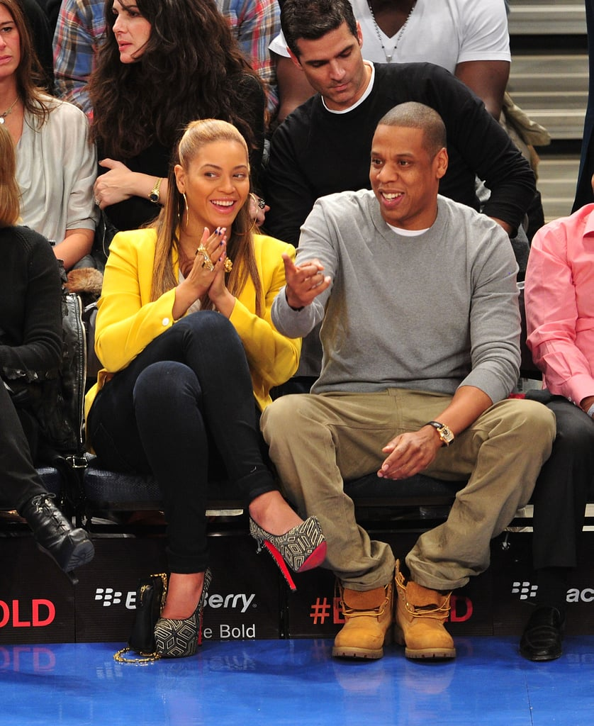 While sitting courtside at a New York Knicks game in February 2012, Beyoncé shone in a bright yellow Rag & Bone blazer and printed platform pumps and Jay Z kept it casual in a gray sweatshirt and khaki pants.
