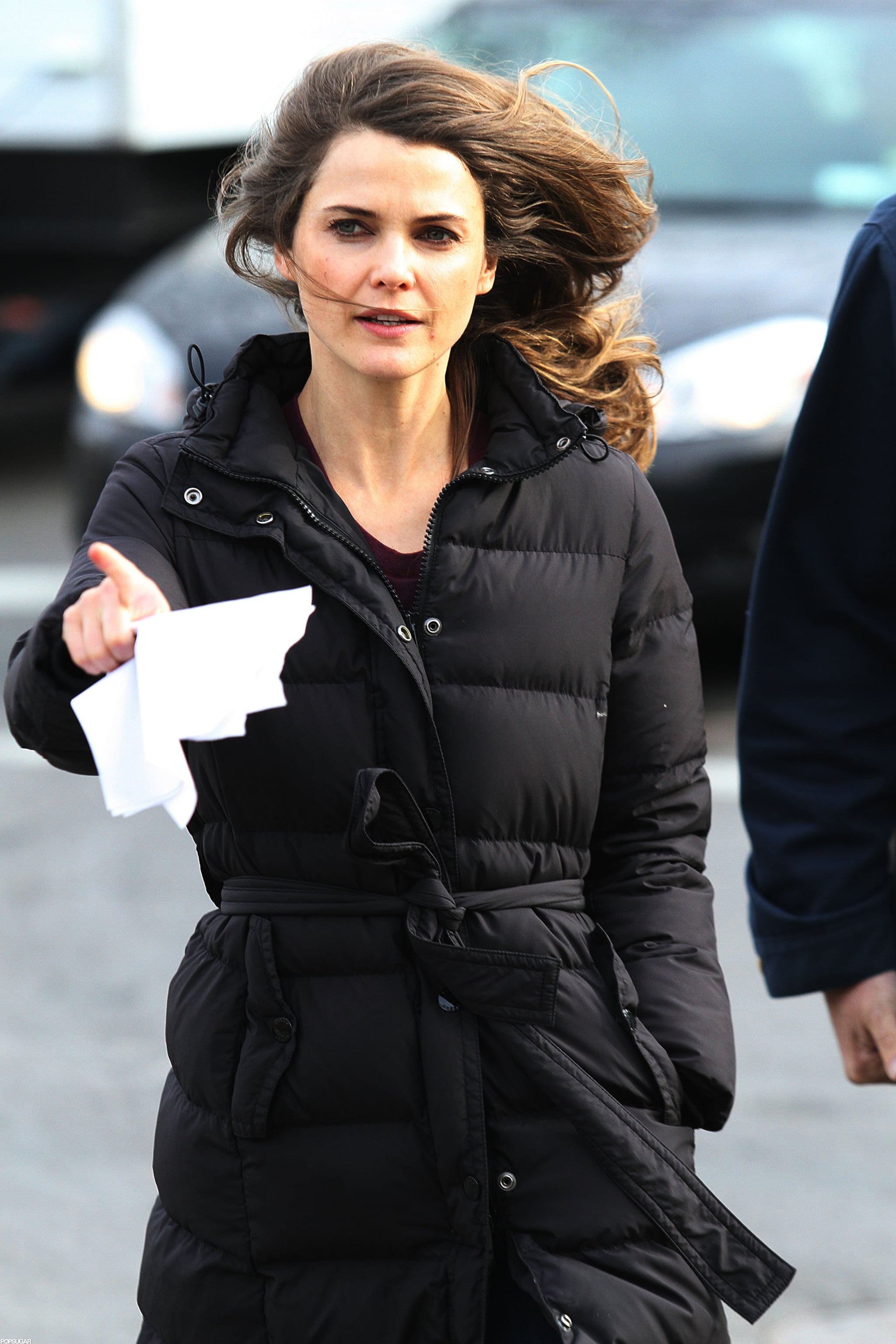 Keri Russell stepped onto set in a black jacket.