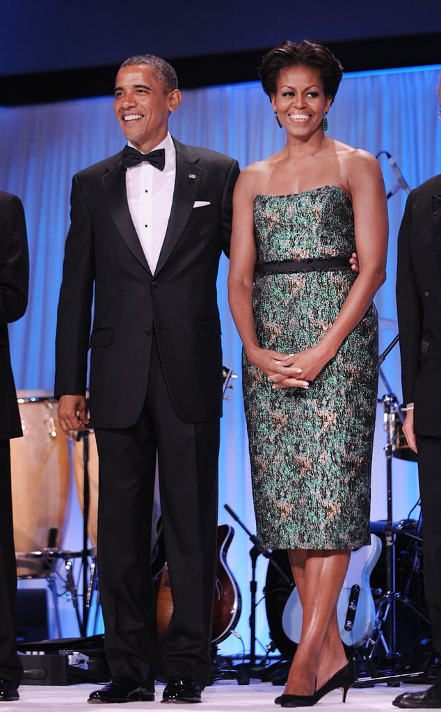 Michelle wore a strapless patterned frock with a black waist sash for an evening out.