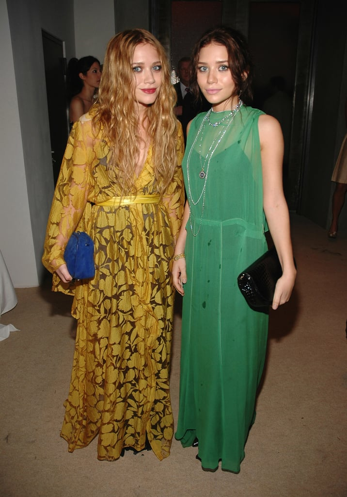 Twinning combo: For the 2006 CFDA/Vogue Fashion Fund Awards, the girls donned Autumn-friendly hues and textured box clutches.  Mary-Kate was Fall-ready in a leafy mustard-yellow wrap gown and suede cobalt clutch. Ashley played up her dark locks in a sheer green dress, black patent leather clutch, and a few layered necklaces.