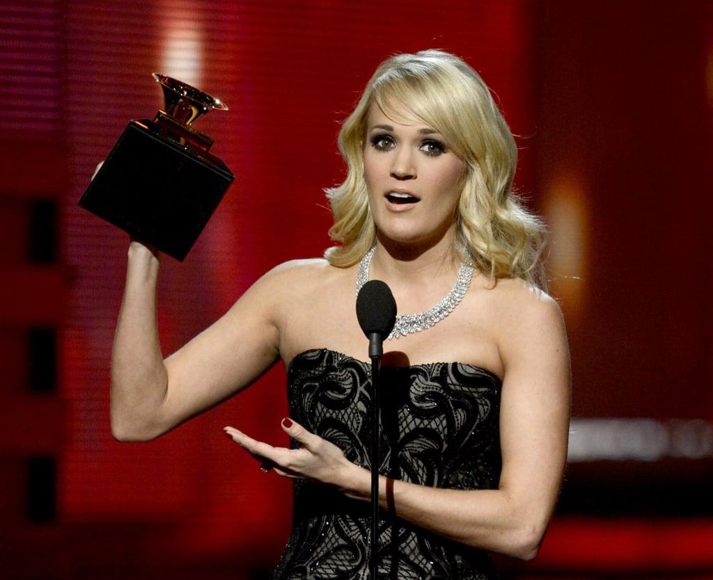 Carrie Underwood held up her Grammy award.