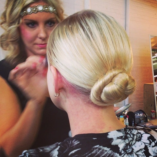 This winding chignon was sleek and smooth at Alice + Olivia.
