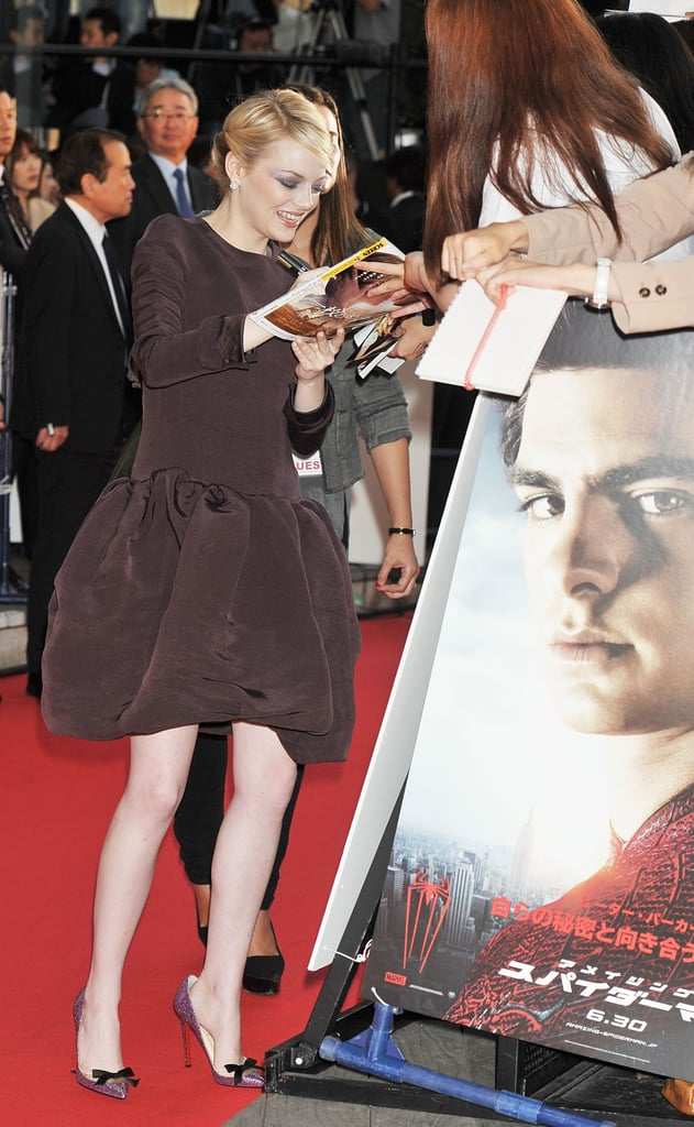 Emma Stone signed autographs at The Amazing Spider-Man premiere in Japan.