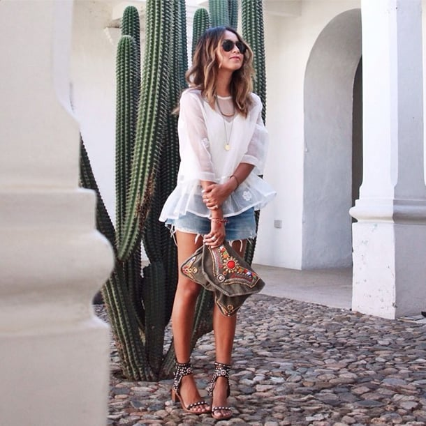 A white, gauzy blouse helps you achieve instant boho flair. Source: Instagram user sincerelyjules