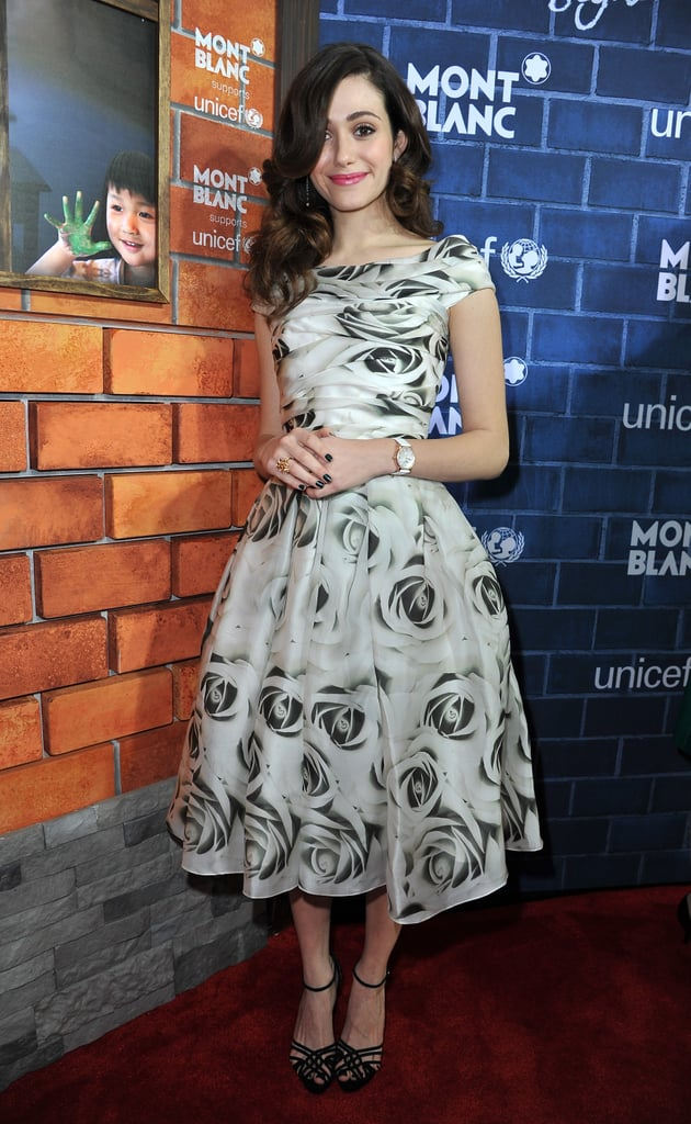 Emmy Rossum tapped into her ladylike side in a fit-and-flare floral dress at the Montblanc and UNICEF pre-Oscars brunch in LA.