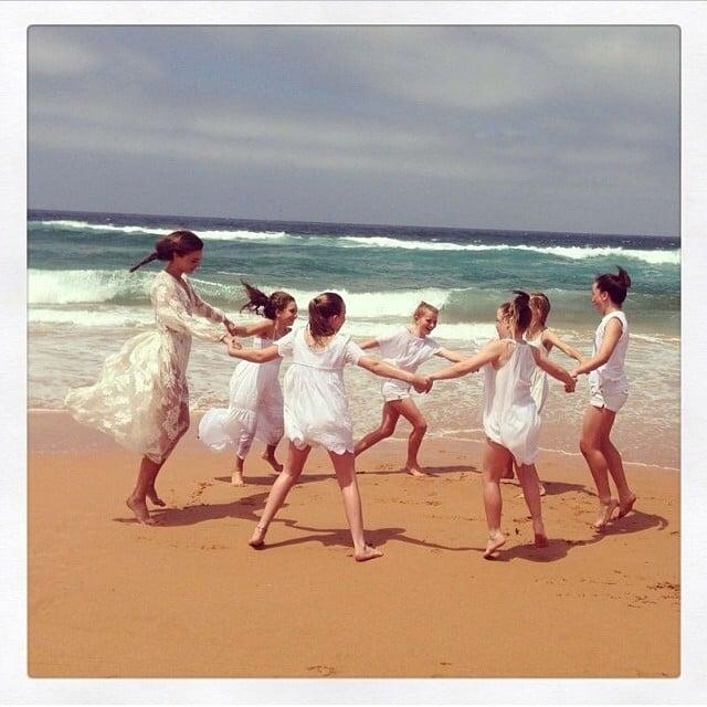 Miranda Kerr celebrated International Women's Day by dancing in a circle with little girls. Aww! Source: Instagram user mirandakerr