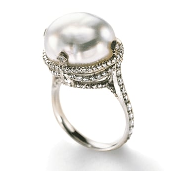 Listen, we're not even going to pretend we know how much this gorgeous pearl-set diamond ring costs because you actually have to inquire within . . . but it's worth the curiosity. We're feeling the old-school vibe completely and can't get the idea of living out our Downton Abbey dreams with this one.