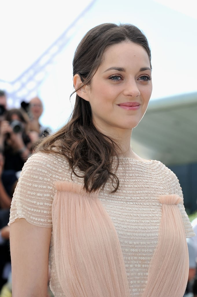 Marion Cotillard wore a light pink Dior gown for the Rust and Bone press conference at the Cannes Film Festival.