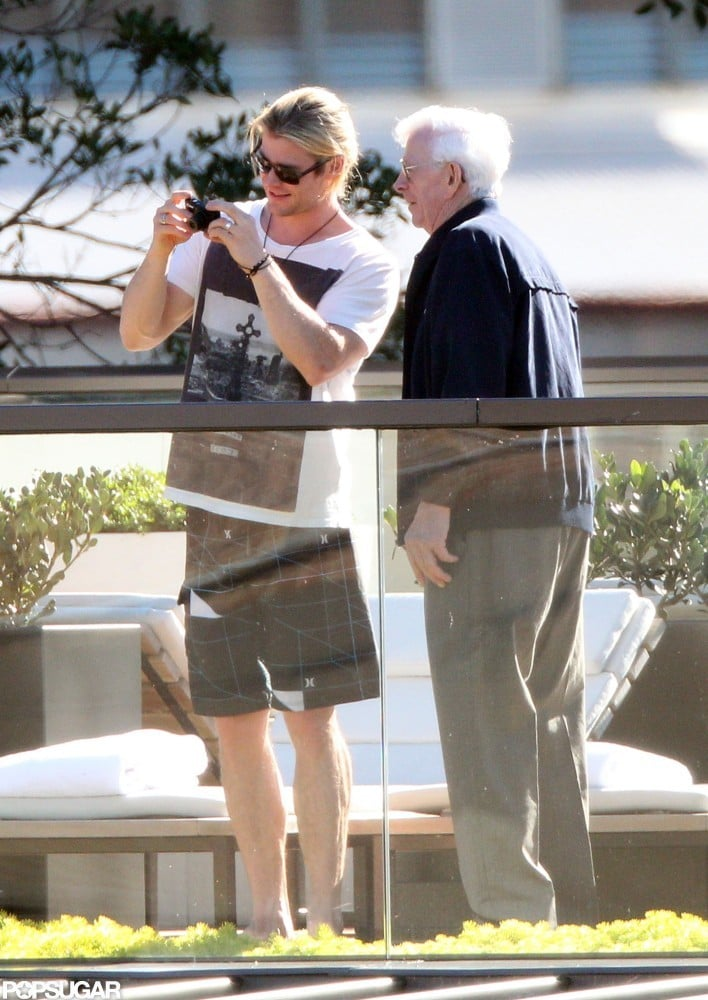 Chris Hemsworth snapped pictures with his grandfather in Sydney on Sunday.