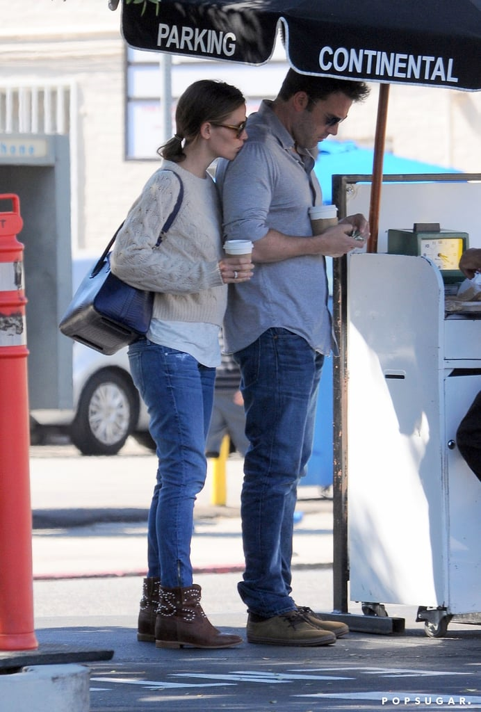 Jennifer planted a sweet smooch on Ben's shoulder as they waited at valet after lunch in LA in August 2013.