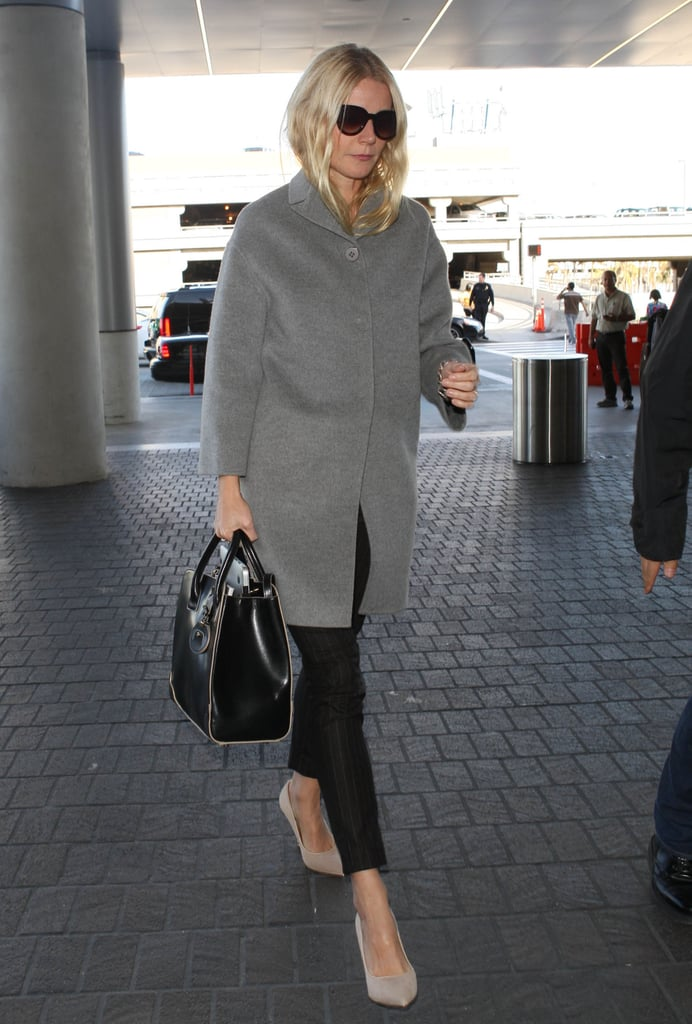 Gwyneth Paltrow kept things cool in neutrals with a gray coat, matchstick pants, and a sleek pair of heels.