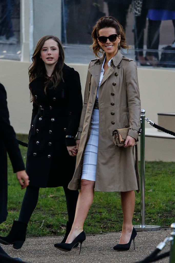 Outside the Burberry Prorsum show, Kate Beckinsale rocked a military-style Burberry trench coat and cat-eye sunglasses.