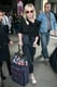 Kirsten Dunst's tweed suitcase paired well with her black top and jeans, making it seem like part of her look rather than something extra.