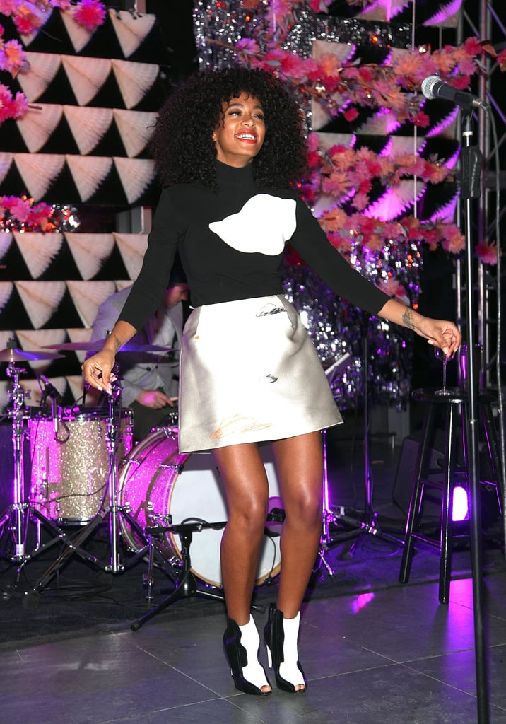 Solange entertained the NYC crowd at The Armory Party donning a cloud-print turtleneck and printed miniskirt, both by Vika Gazinskaya, with black-and-white booties.