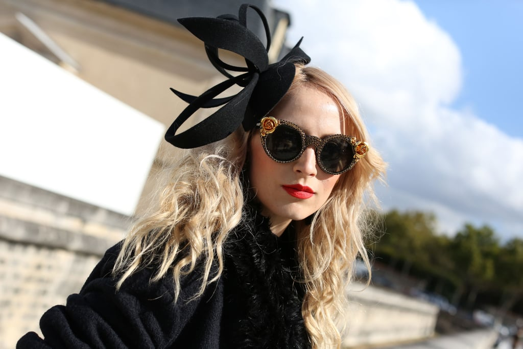 An attention-getting fascinator and embellished glasses made for a dramatic pair.