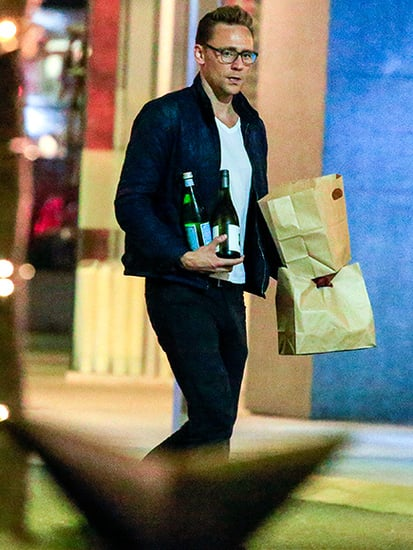 Couple's Night In? Tom Hiddleston Picks Up Dinner (and Wine) To-Go in Australia