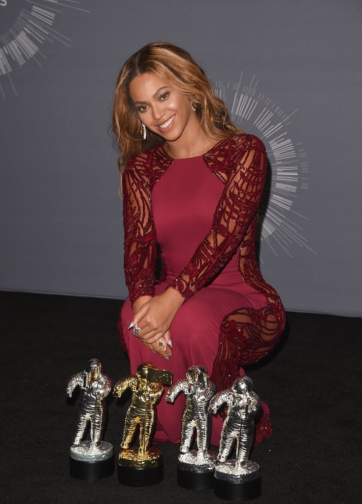 2014: After closing the show in the fiercest way possible, Beyoncé posed in the press room with her four Moonmen.