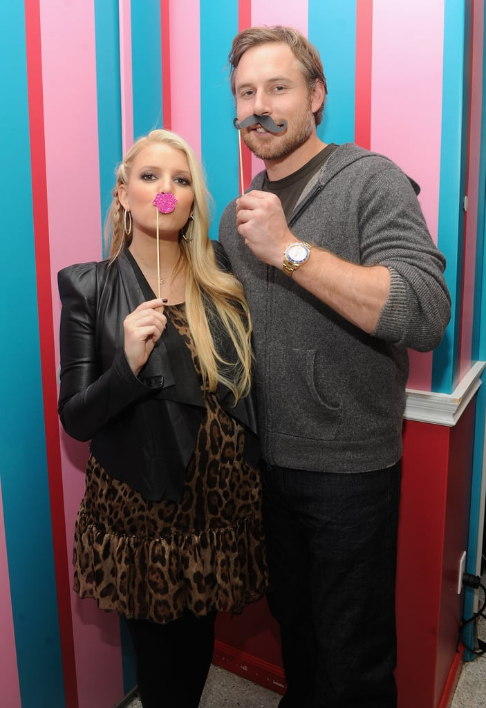 Eric accompanied Jessica to an event celebrating her girls' clothing collection at Dylan's Candy Bar in NYC in November 2011.