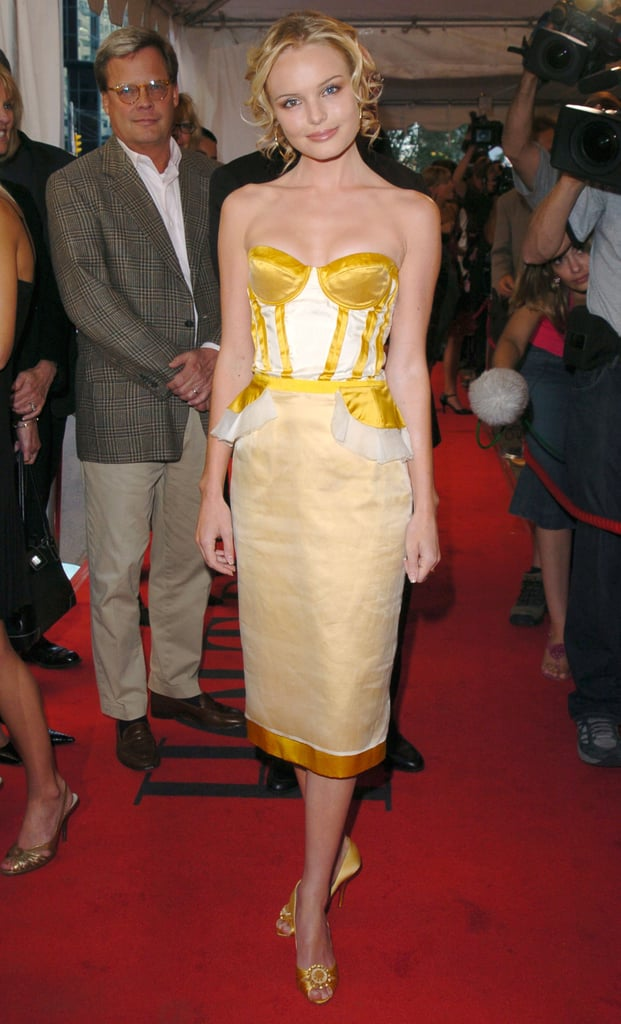 At the 2004 Toronto International Film Festival, Kate stepped out in a corseted, not-so-mellow yellow Proenza Schouler creation, coordinating jewelled peep-toes, and face-framing curls.
