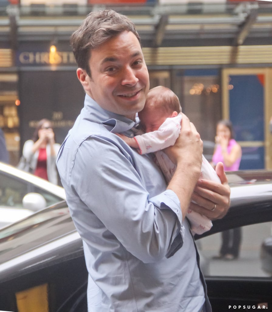 Proud dad Jimmy Fallon showed off his newborn daughter, Winnie Rose, while leaving his home in NYC.