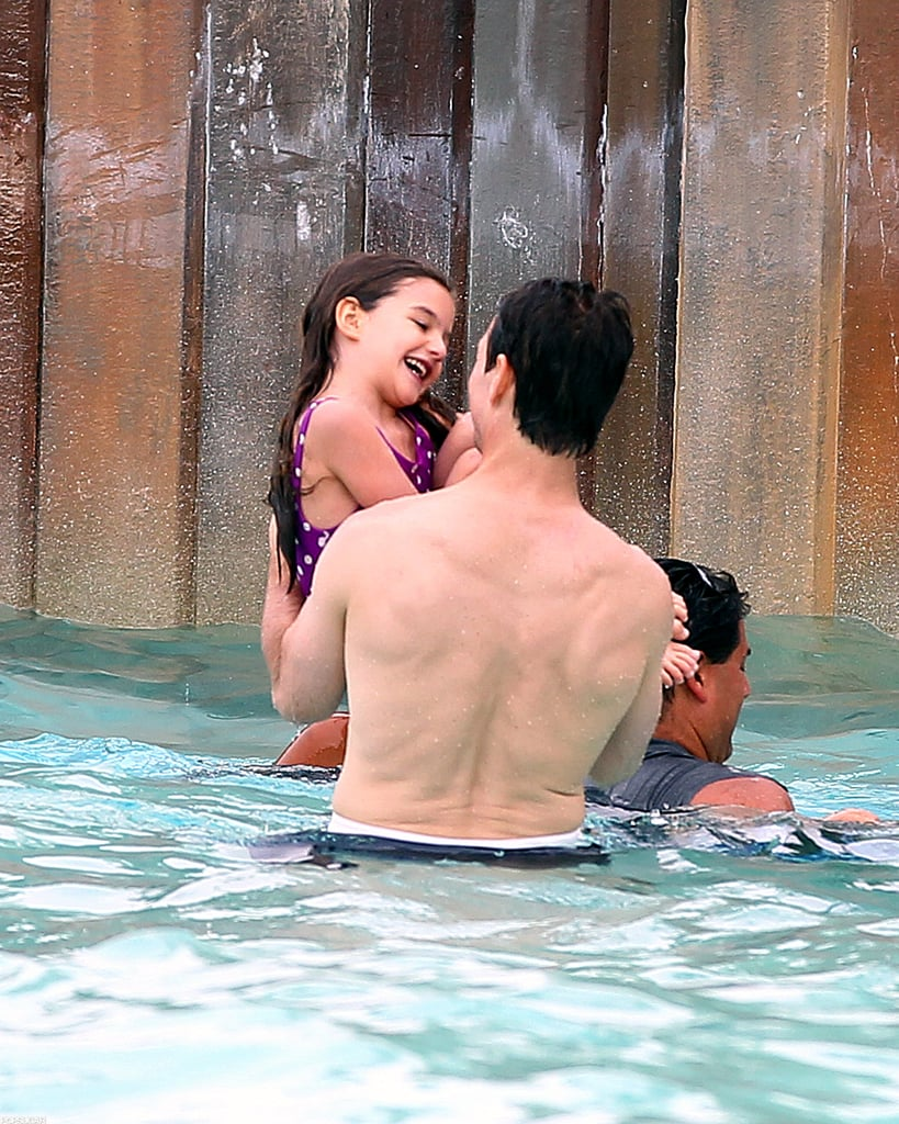 Suri Cruise was all smiles as she and Tom Cruise played at the water park.