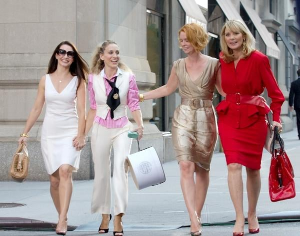 It isn't unusual to spot Samantha Jones in a structured red power suit.