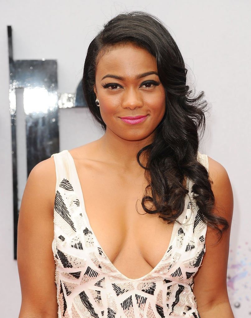 Tatyana Ali mixed Old Hollywood hair with a modern lip color for a look that was both current and classic.