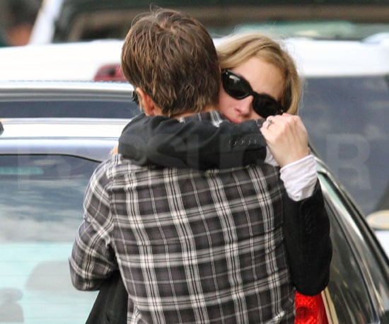 Slide Photo of Julia Roberts and Danny Moder Hugging Outside LAX