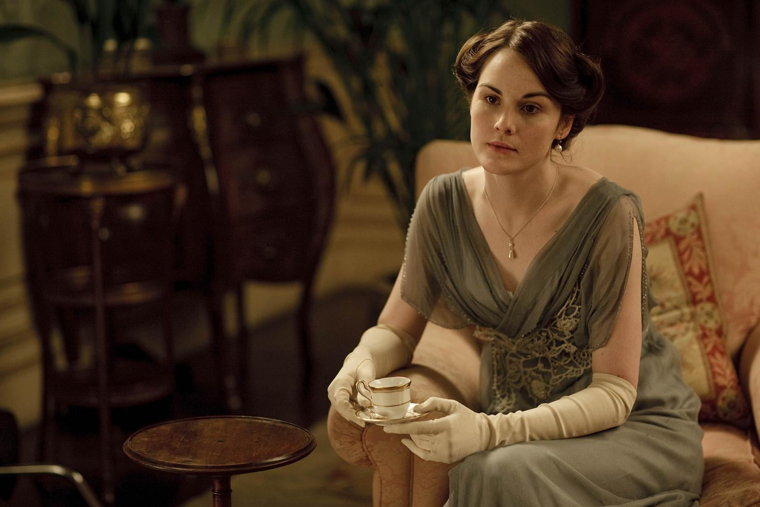 """Ever notice how nobody wears her hair down at Downton Abbey in the earlier seasons? That's not by accident. Only little girls and """"loose"""" women wore their hair down in those days. Wearing hair up, however, showed that she was ready to be presented —and therefore, courted —as a grown woman. Source: ITV"""