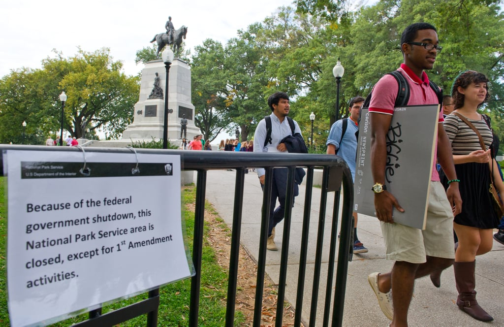 """A sign in Washington DC read, """"Because of the federal government shutdown, the National Park Service area is closed, except for First Amendment activities."""""""