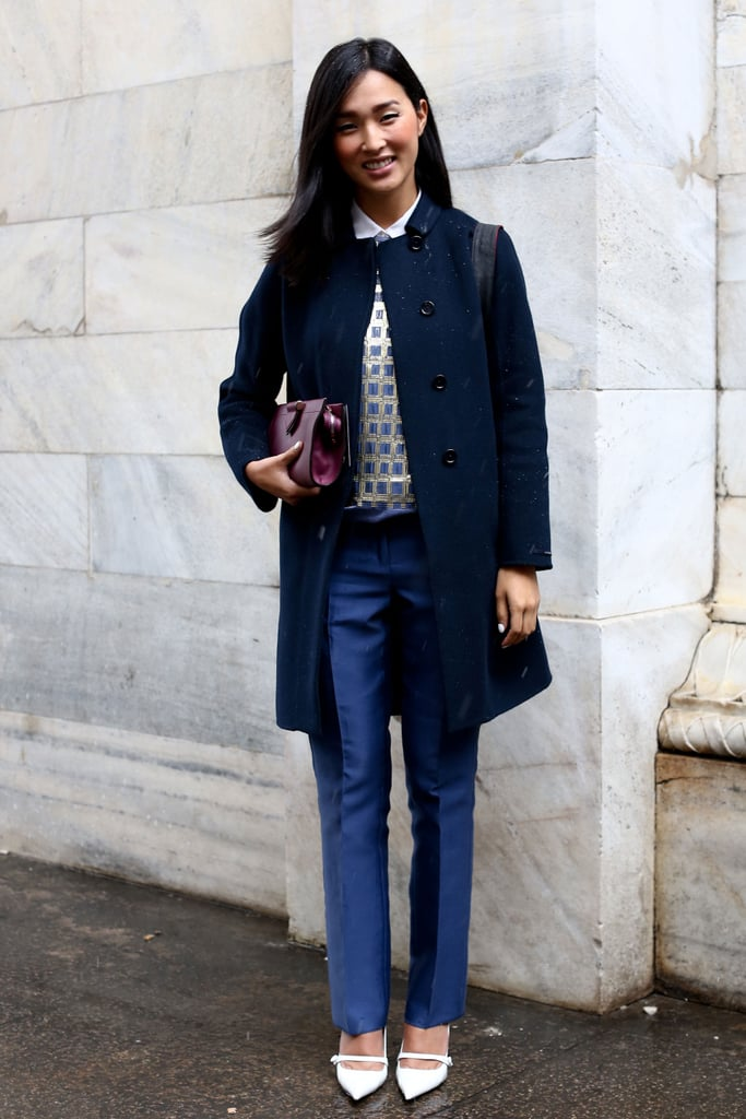 Nicole Warne knows how to rethink the trouser look with an embellished top and chic white heels on bottom.