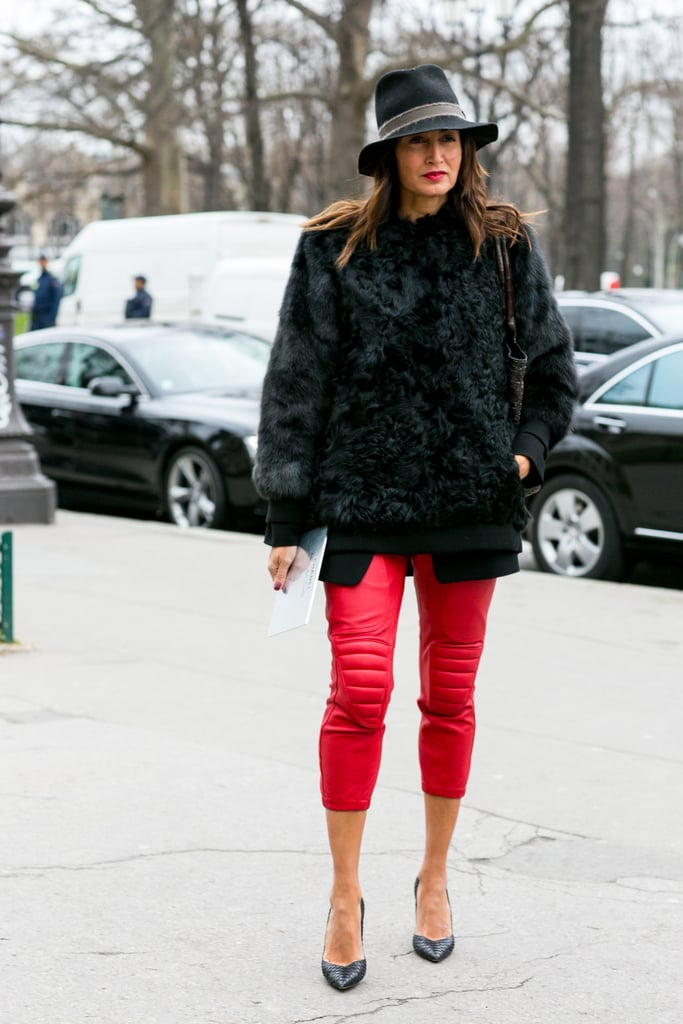 It would be hard not to notice those bright red pants, but with a furry black topper, she created an easy balance.