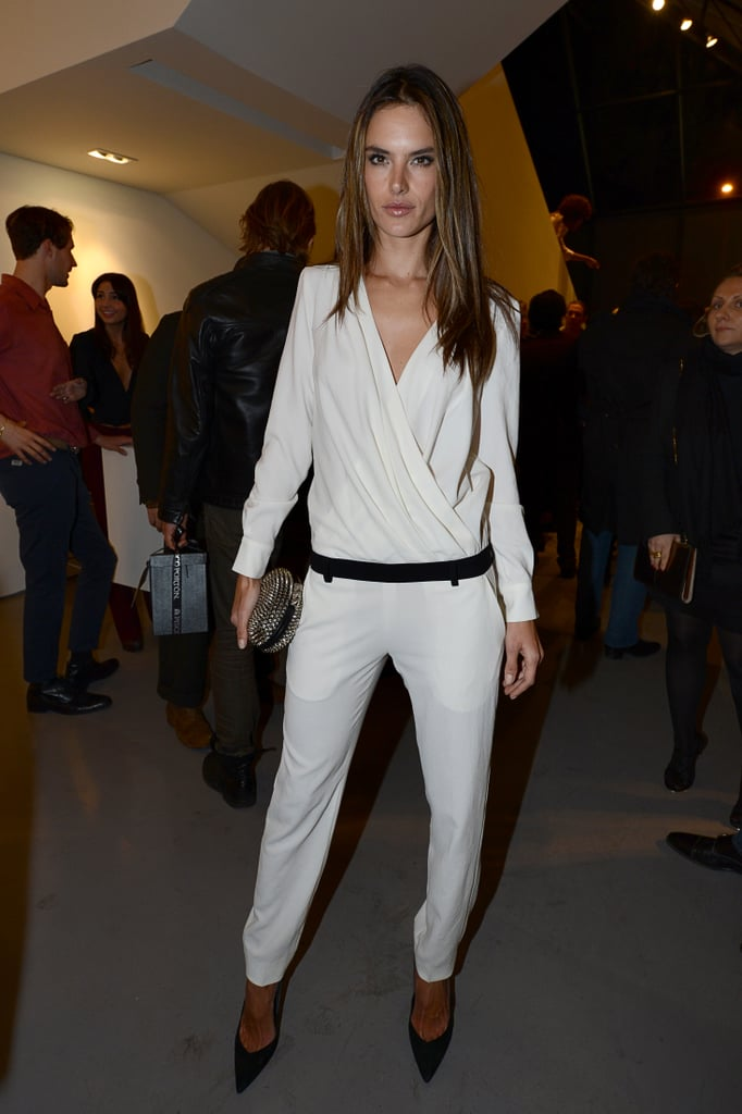 Alessandra Ambrosio stuck to a black and white palette, wearing a white jumpsuit with black accessories at the Mario Testino event.